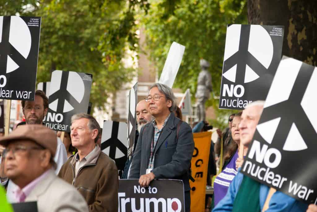 Demonstrators with No nuclear war and No to Trump placards